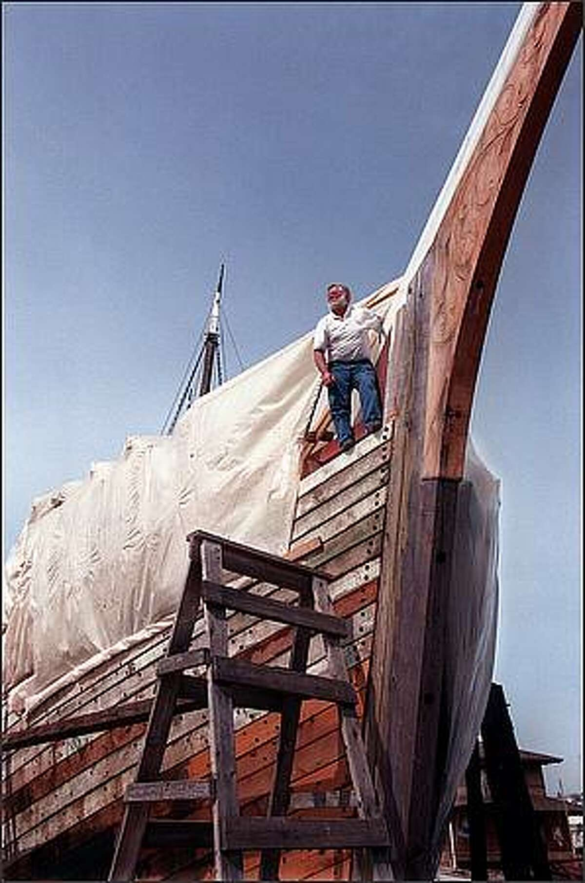 Bill White, shipwright and director of restoration at Northwest Seaport, stands aboard the fruits of his labor, the ongoing restoration of the 1897 schooner Wawona. April 24, 1998.