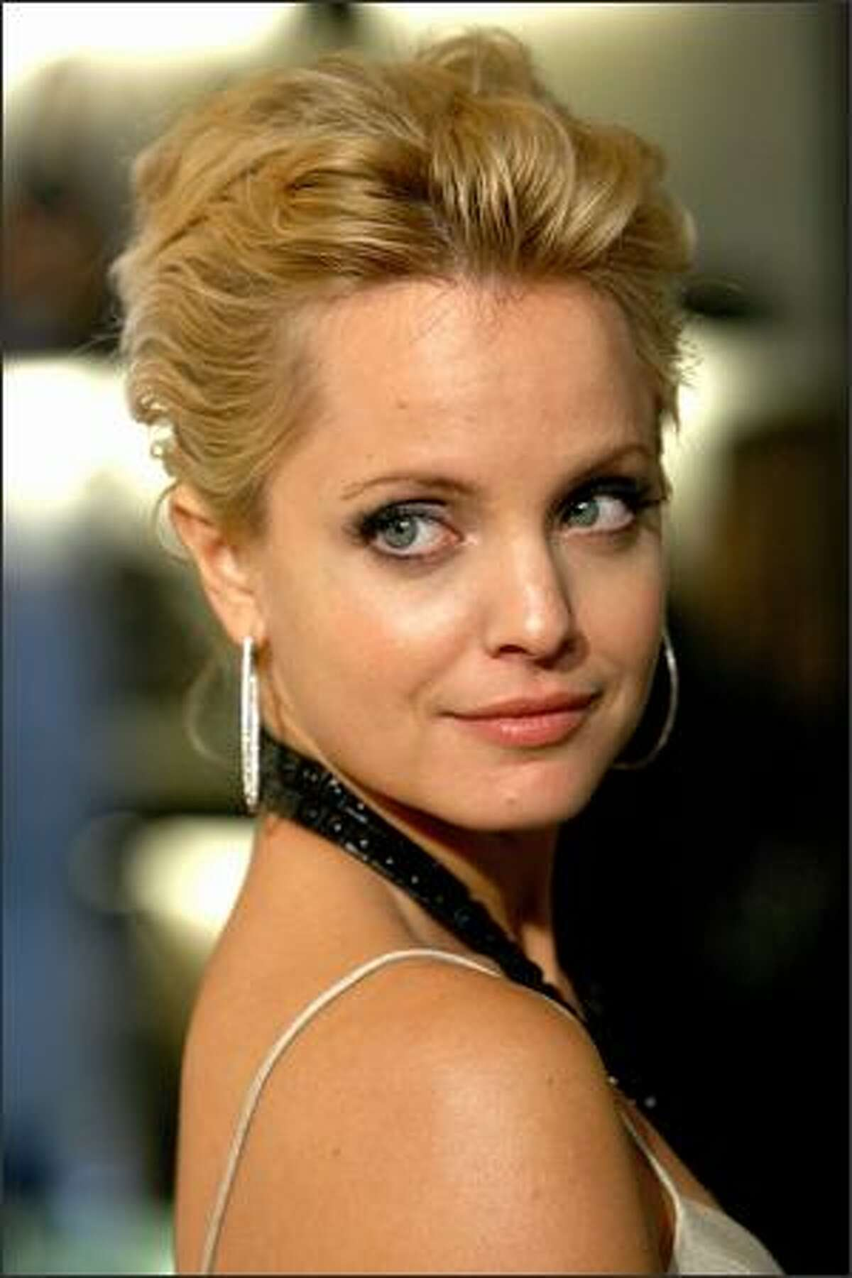 Actress Mena Suvari arrives at the grand re-opening of the Burberry Beverly Hills store in Beverly Hills, California.