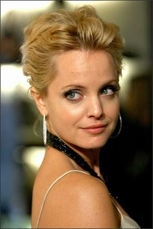 Actress Mena Suvari arrives at the grand re-opening of the Burberry Beverly Hills store in Beverly Hills, California. Photo: Getty Images