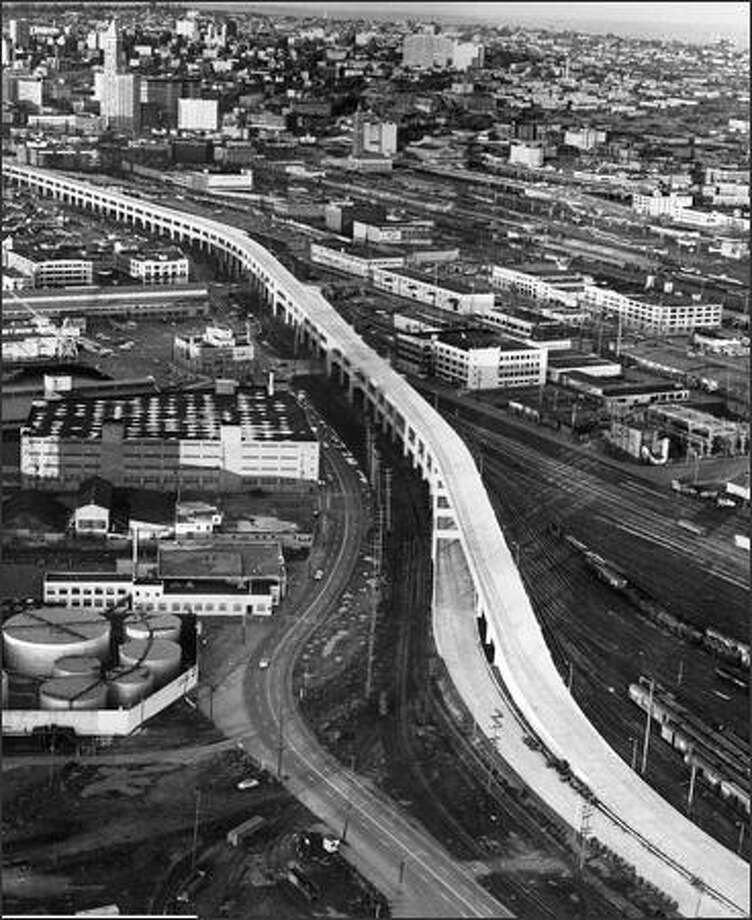 The southern portion of the Alaskan Way Viaduct was completed in late 1958. This photo, taken before cars were allowed on the span, looks northeast, with Smith Tower at upper left. (P-I photo by Phil H. Webber) Photo: Museum Of History And Industry