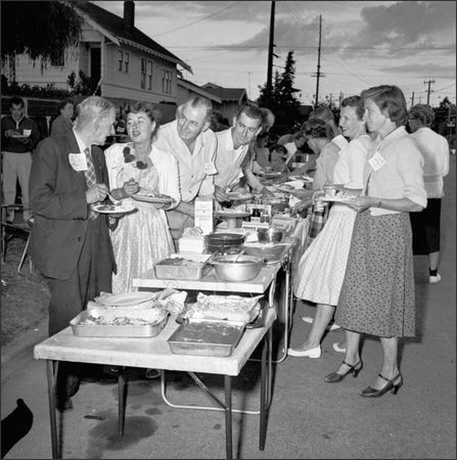 A neighborhood street party, August, 1959. (P-I photo by Phil H. Webber) Photo: Museum Of History And Industry