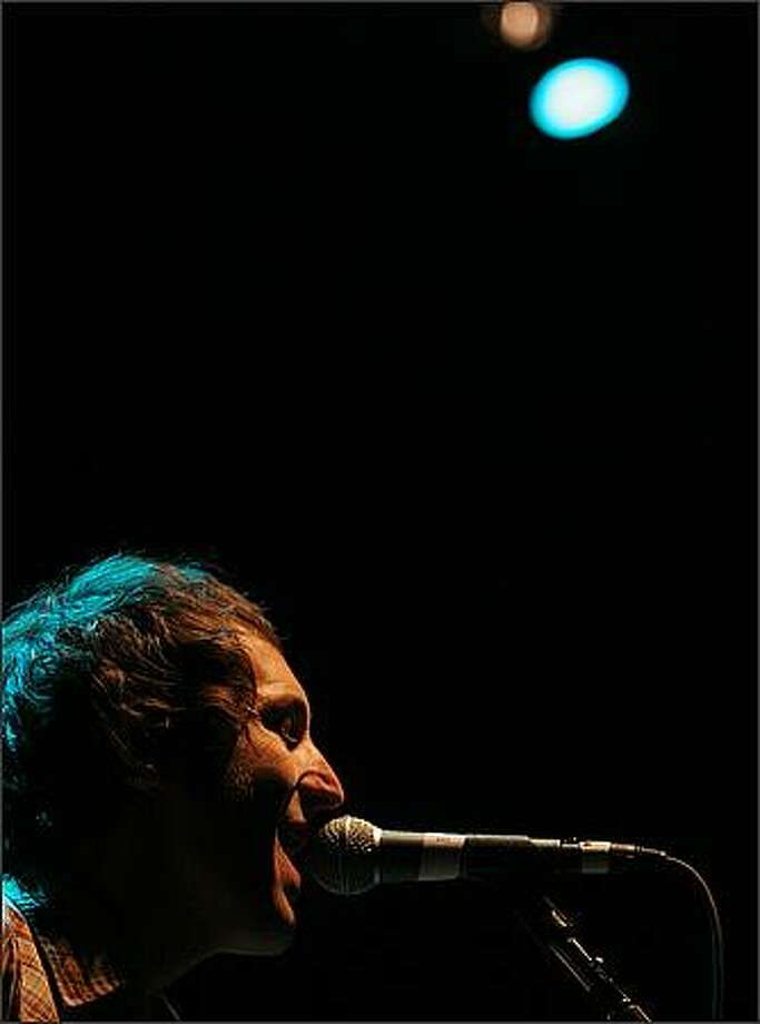 Lead singer for the band Everest, Russell Pollard, plays at Comcast Arena. Photo: Brad Vest, Seattle Post-Intelligencer