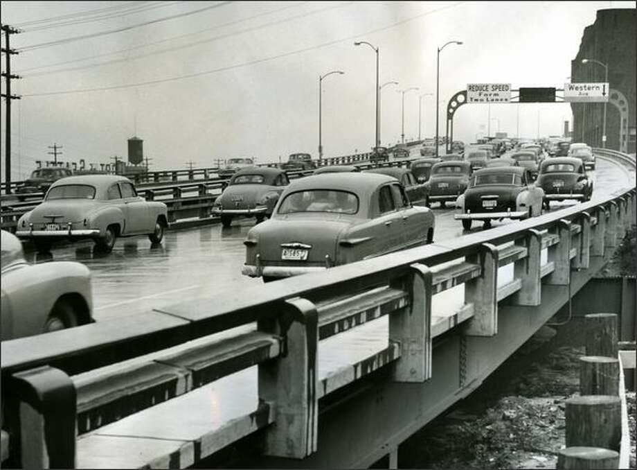 Three lanes of northbound traffic jam up at north end of Alaskan Way viaduct on April 5, 1953. (Seattle P-I photo by Ed Watton) Photo: Museum Of History And Industry