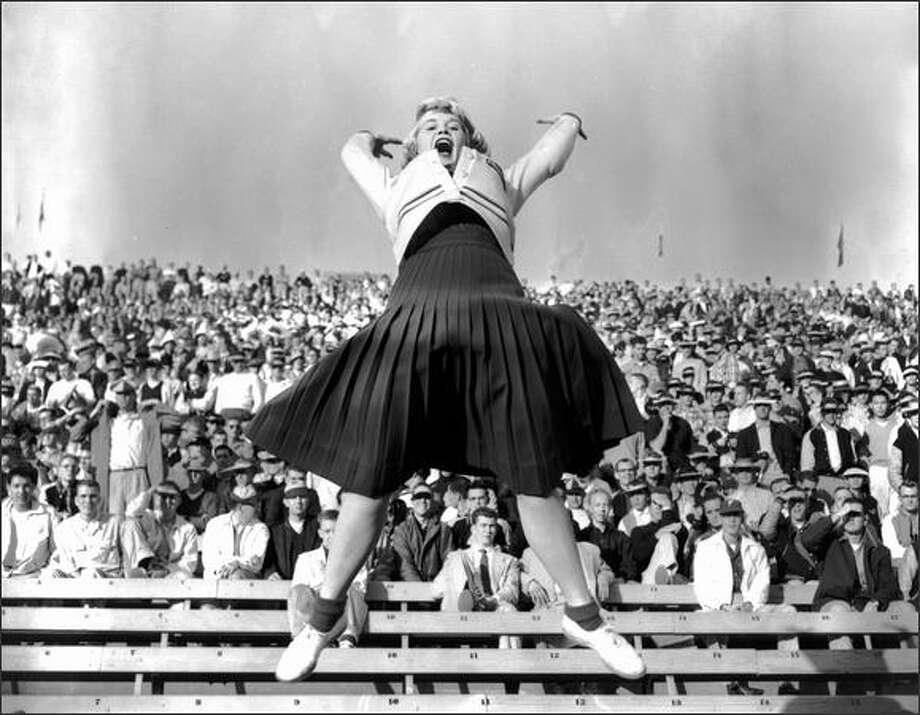 Dottie Provine was a 19-year-old University of Washington cheerleader at this Oct. 11, 1954 game against Oregon. The Ducks won 26-7. (Seattle Post-Intelligencer Collection, Museum of History & Industry 86.5.39.568) Photo: Museum Of History And Industry
