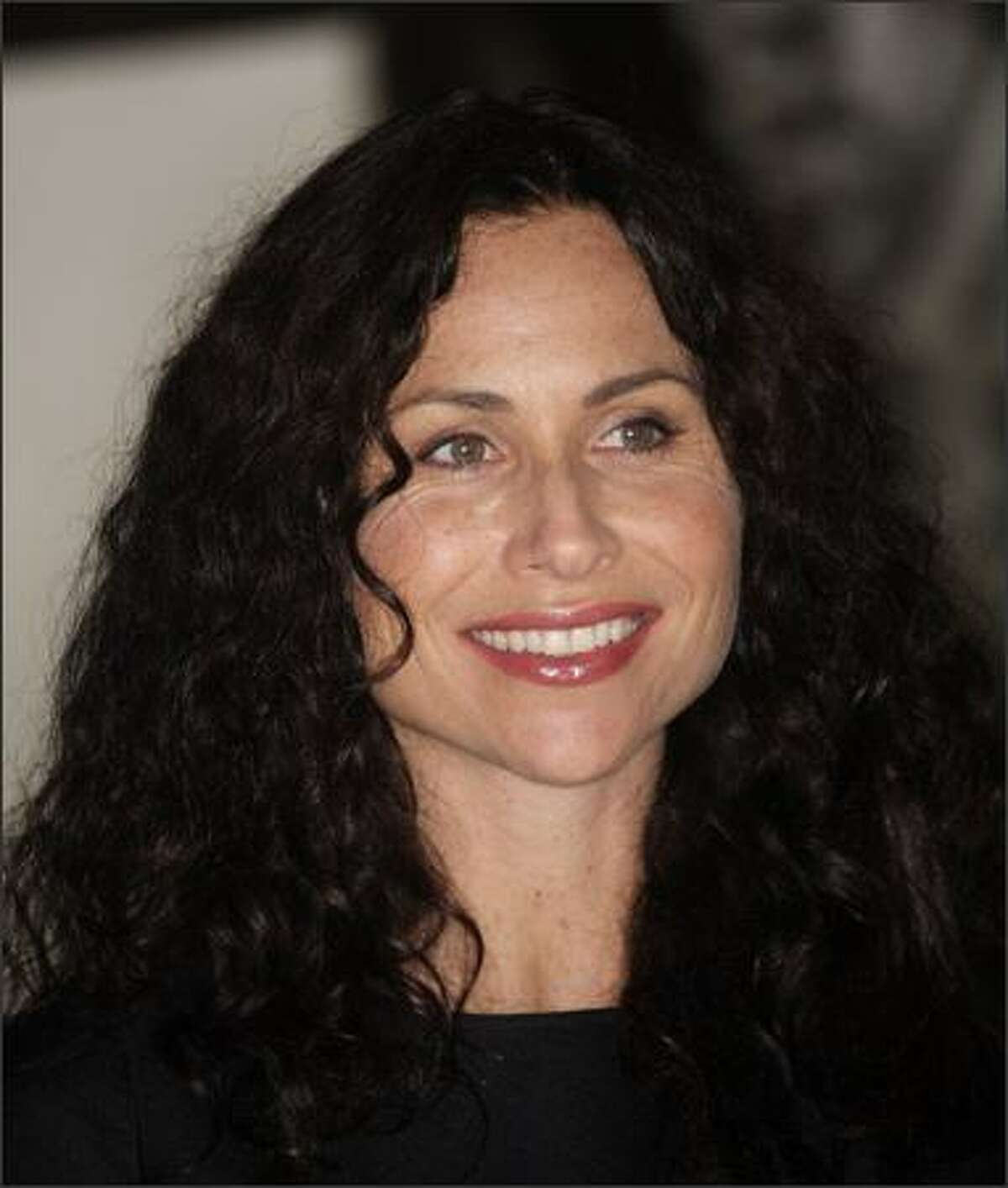 Actress Minnie Driver attends the grand opening party.