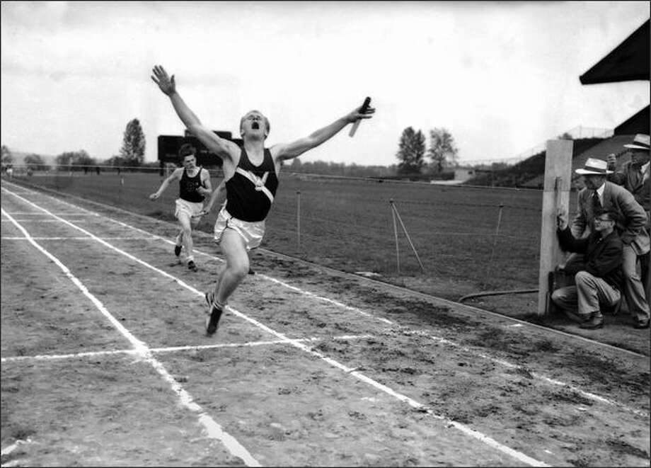 "As official timers concentrate with stopwatches at right, a Seattle high school athlete breaks the string at the finish of a relay race in 1954. This was the same year that track made international headlines as England's Sir Roger Bannister broke the 4-minute ""barrier"" by running a mile in 3:59:4 on May 6, 1954. Photo: Museum Of History And Industry"
