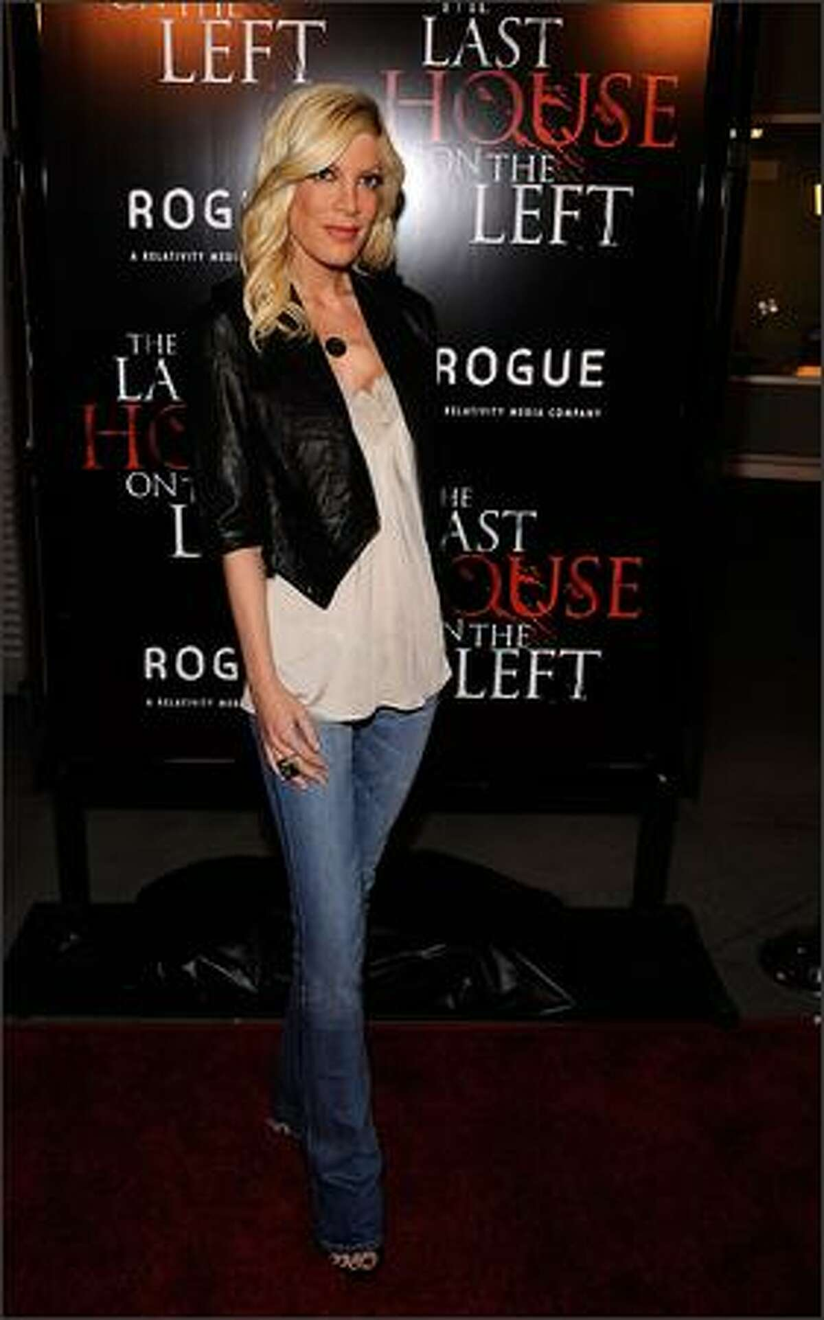 Actress Tori Spelling arrives at the Premiere of Rogue Pictures'