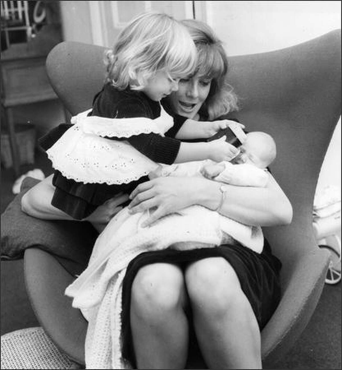 Jan. 19, 1965: English actress Vanessa Redgrave with her two daughters, 20-month old Natasha Jane and new-born Joely Kim Richardson. She is married to film director, Tony Richardson.