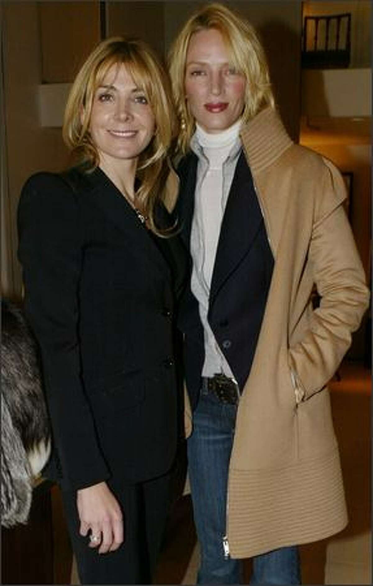 Actresses Natasha Richardson and Uma Thurman attend the opening of the Asprey Flagship Store on Fifth Avenue in New York, Dec. 8, 2003.