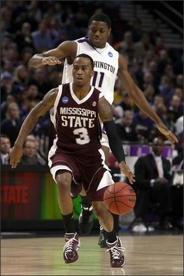 Dee Bost of Mississippi State moves the ball in front of Matthew Bryan-Amaning of Washington in the first half. Photo: Getty Images
