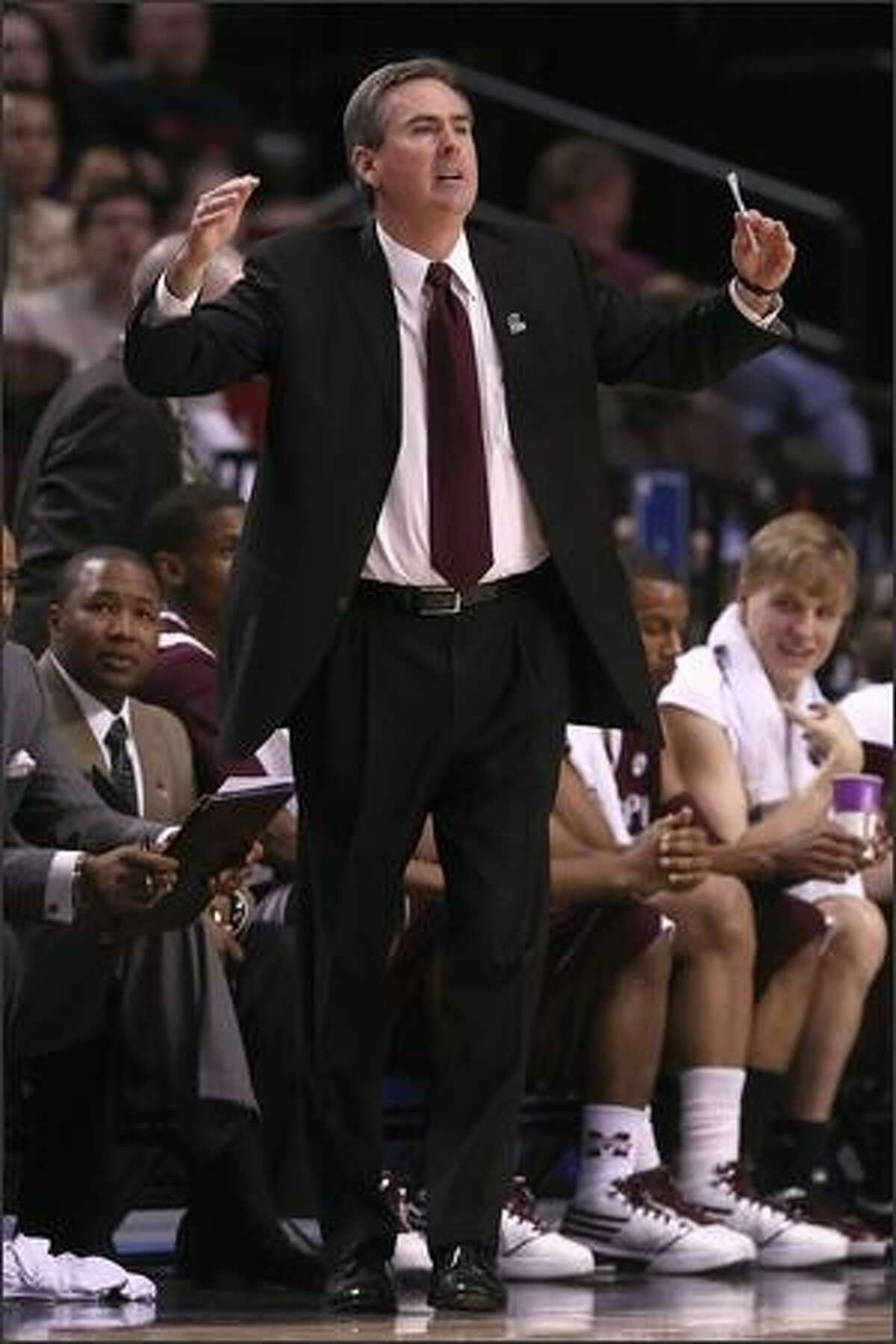 Head coach Rick Stansbury of Mississippi State reacts in the first half.