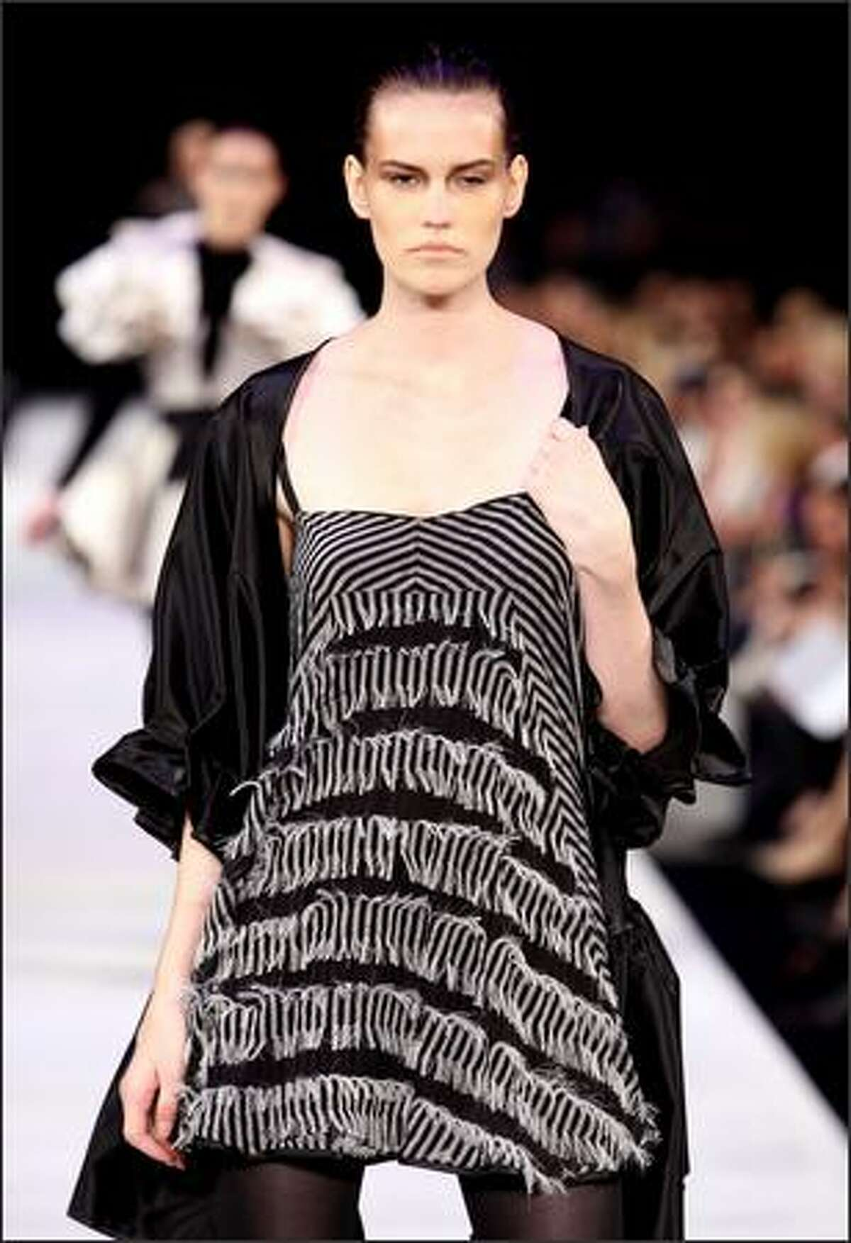 A model showcases a design on the catwalk by Made in Donald at the Independent Runway presented by Network Ten during L'Oreal Melbourne Fashion Festival 2009 at the Peninsula Central Pier Docklands in Melbourne, Australia.