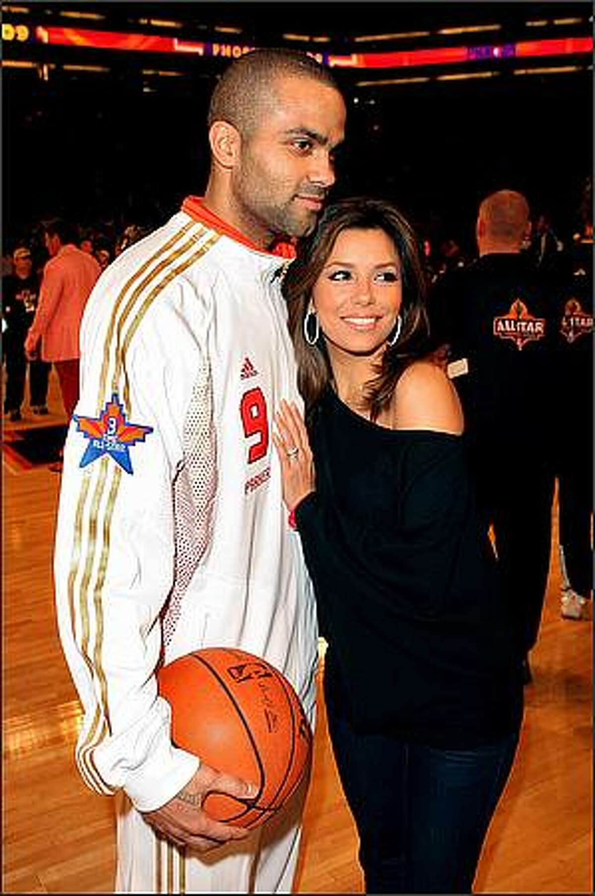 Tony Parker of the Western Conference poses with his wife, actress Eva Longoria Parker, during the 58th NBA All-Star Game. (Photo by Jason Merritt/Getty Images)