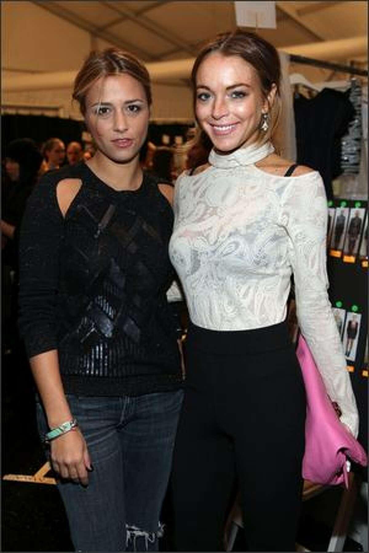 Designer Charlotte Ronson (left) and actress Lindsay Lohan pose backstage at the Charlotte Ronson show.