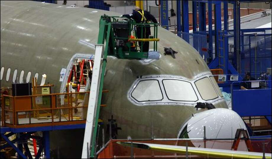 Boeing employees work on a 787 on the assembly lines Jan. 30 at Boeing's production plant in Everett. Photo: Gilbert W. Arias/Seattle Post-Intelligencer