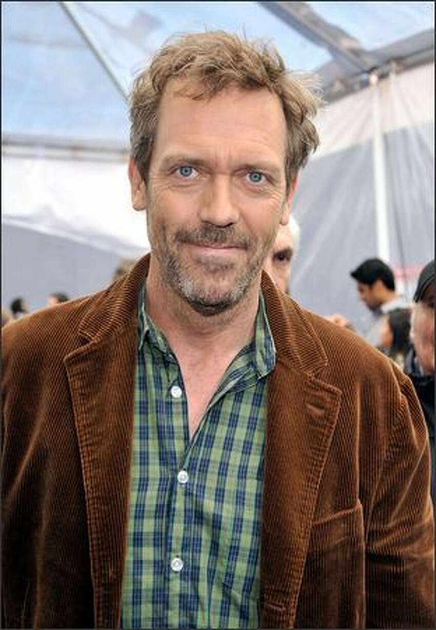 Actor Hugh Laurie arrives at the premiere of Dreamworks'