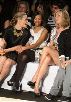 From left, model Molly Sims, actress Zoe Saldana and model Heidi Klum attend the Diane Von Furstenberg show. Photo: Getty Images