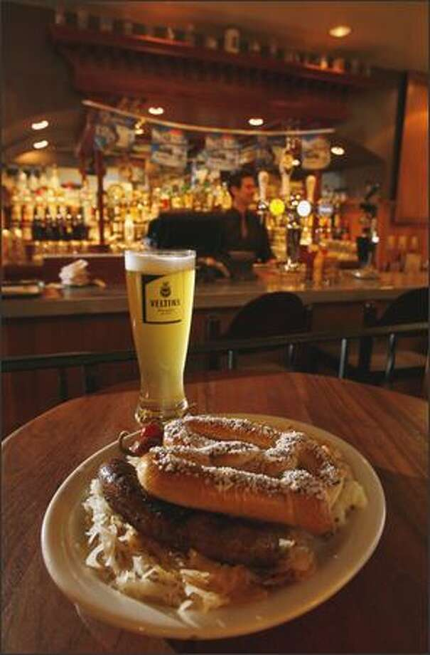 Shultzy's German Bratwurst Plate ($9.99) features a brat with sauerkraut, warm German potato salad and a hot pretzel. Photo: Mike Urban/Seattle Post-Intelligencer