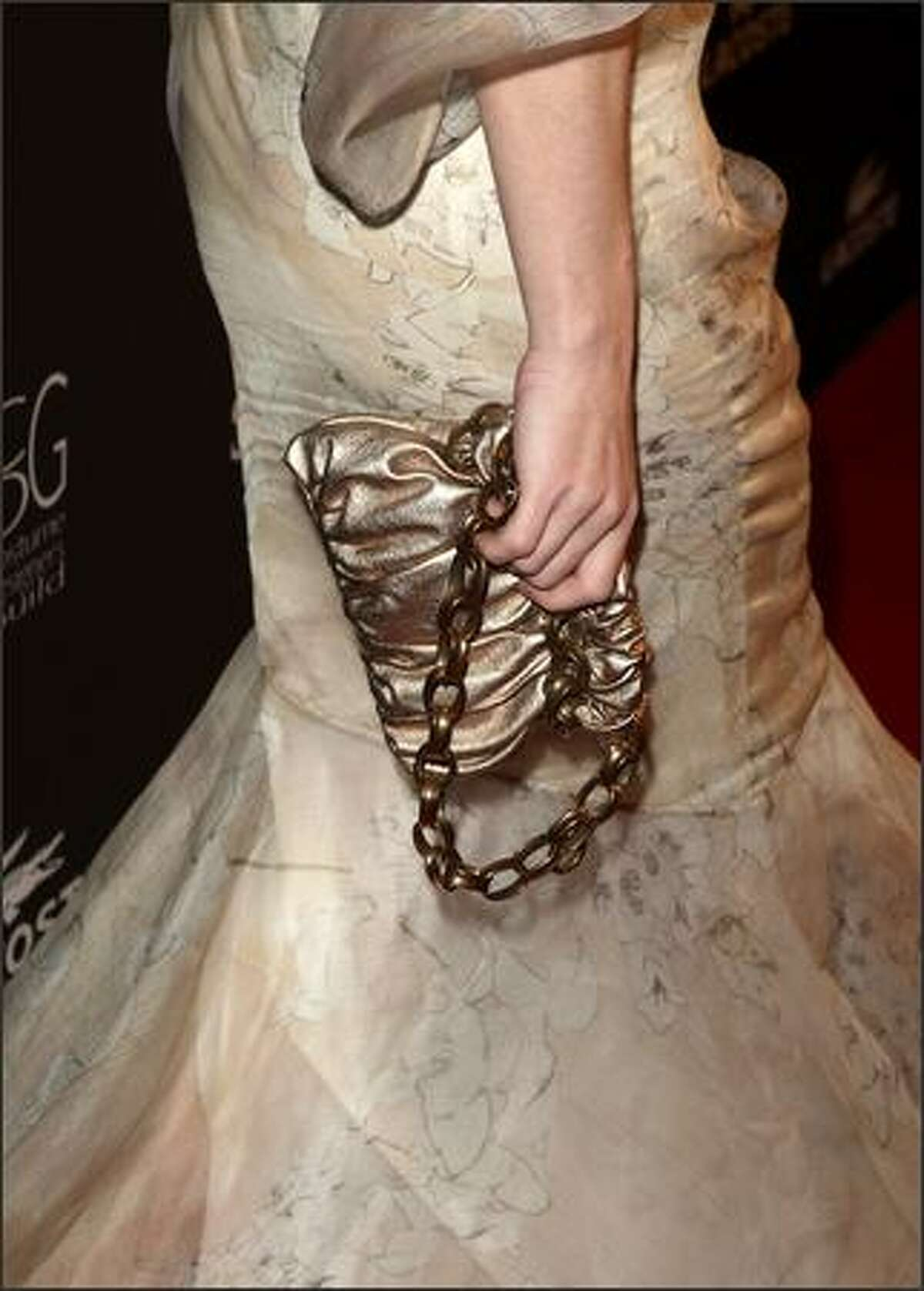 Actress Melissa George (handbag detail) arrives.