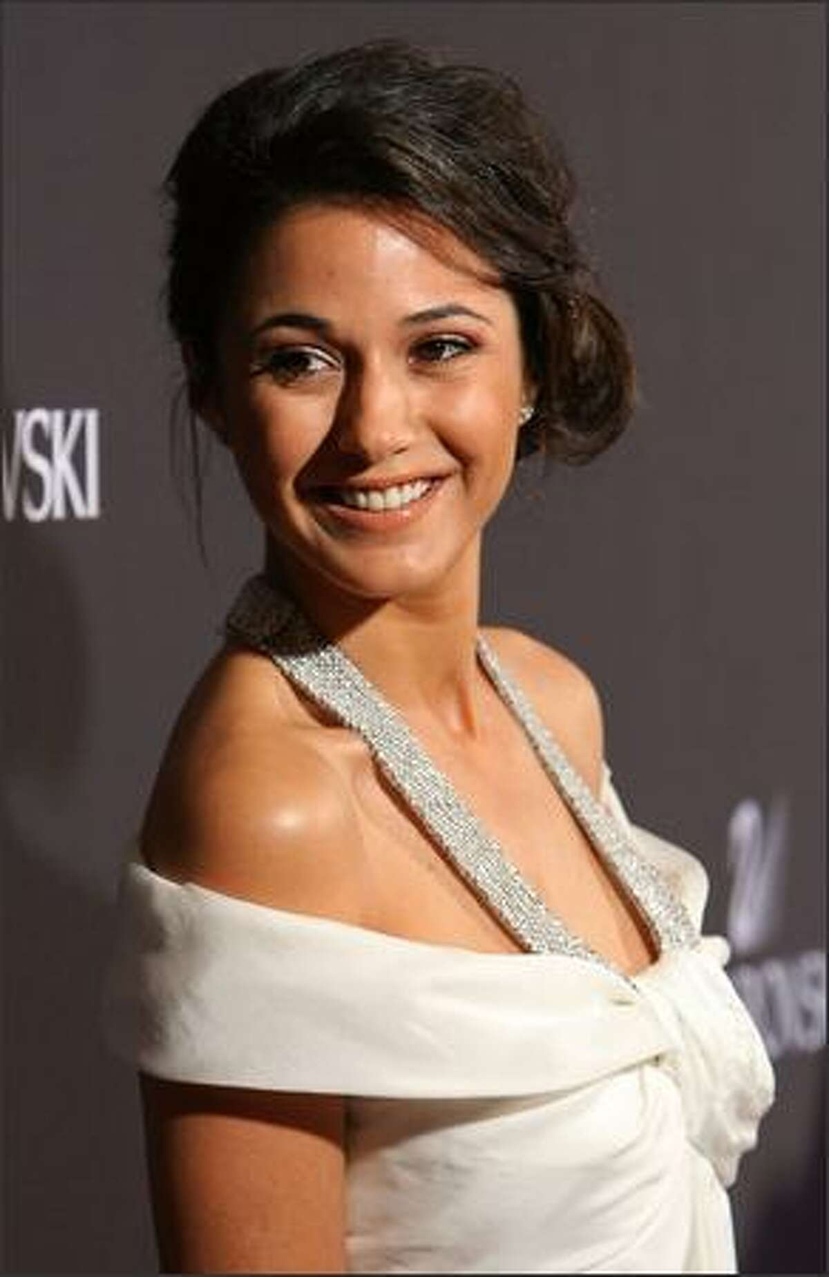 Actress Emmanuelle Chriqui arrives.