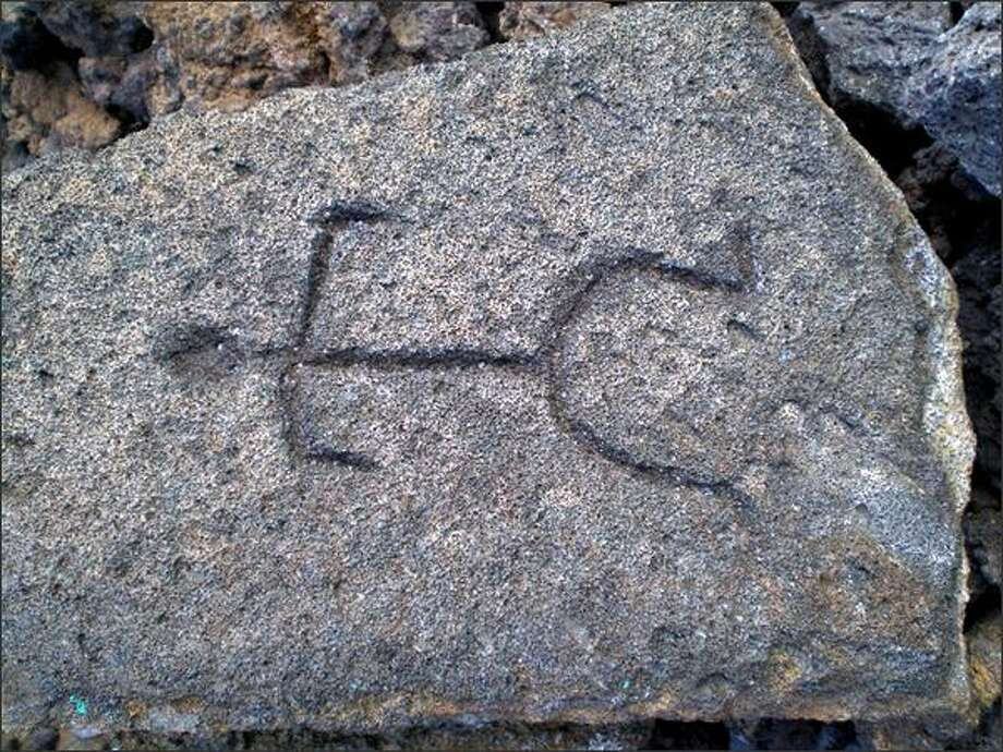 Stick figures are one type of petroglyph found at Puako. Photo: Stephanie Levin