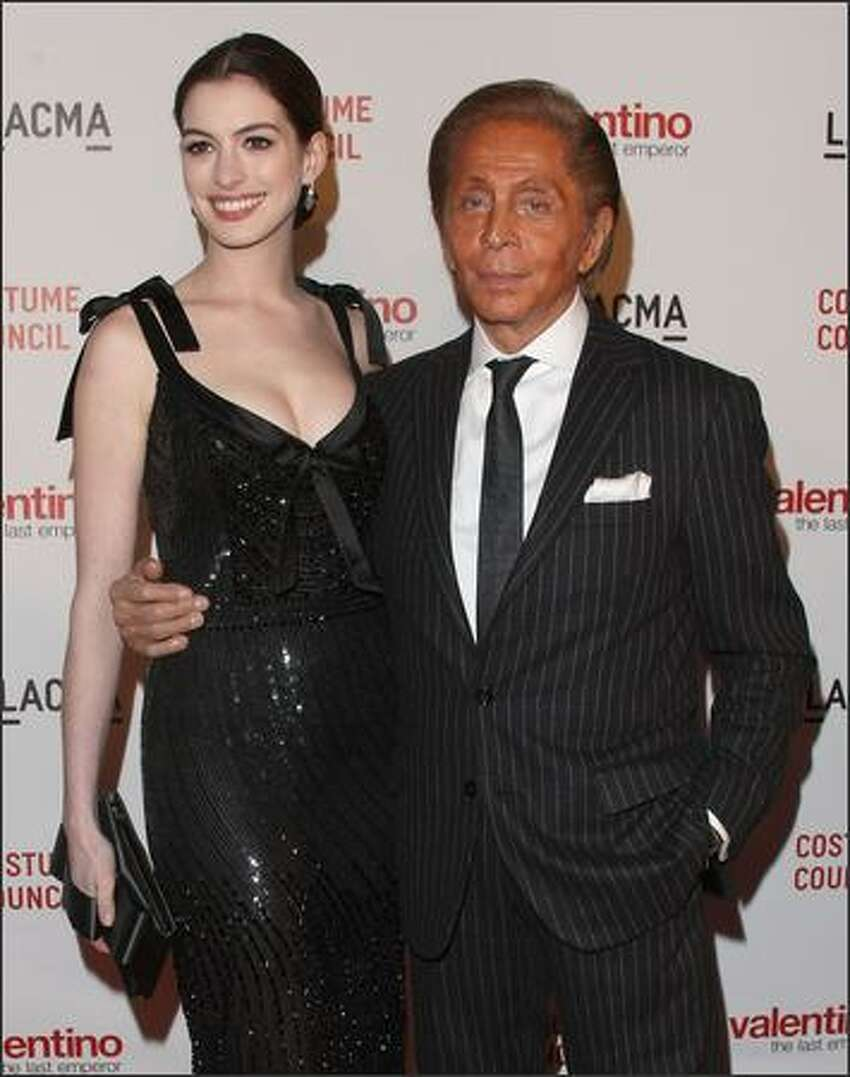 Actress Anne Hathaway and designer Valentino attend the Los Angeles premiere of
