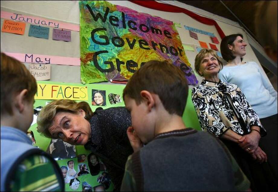 Preschoolers talk with Gov. Chris Gregoire on Tuesday in Seattle after Bette Hyde, second right, was named director of Early Learning. Photo: Andy Rogers/Seattle Post-Intelligencer