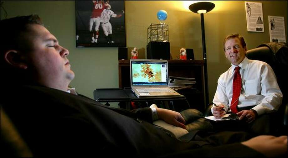 Craig Sigl, right, is a hypnotherapist who helps athletes and others deal with their mental game. At left is Brock Brady of Bellevue. Photo: Scott Eklund/Seattle Post-Intelligencer