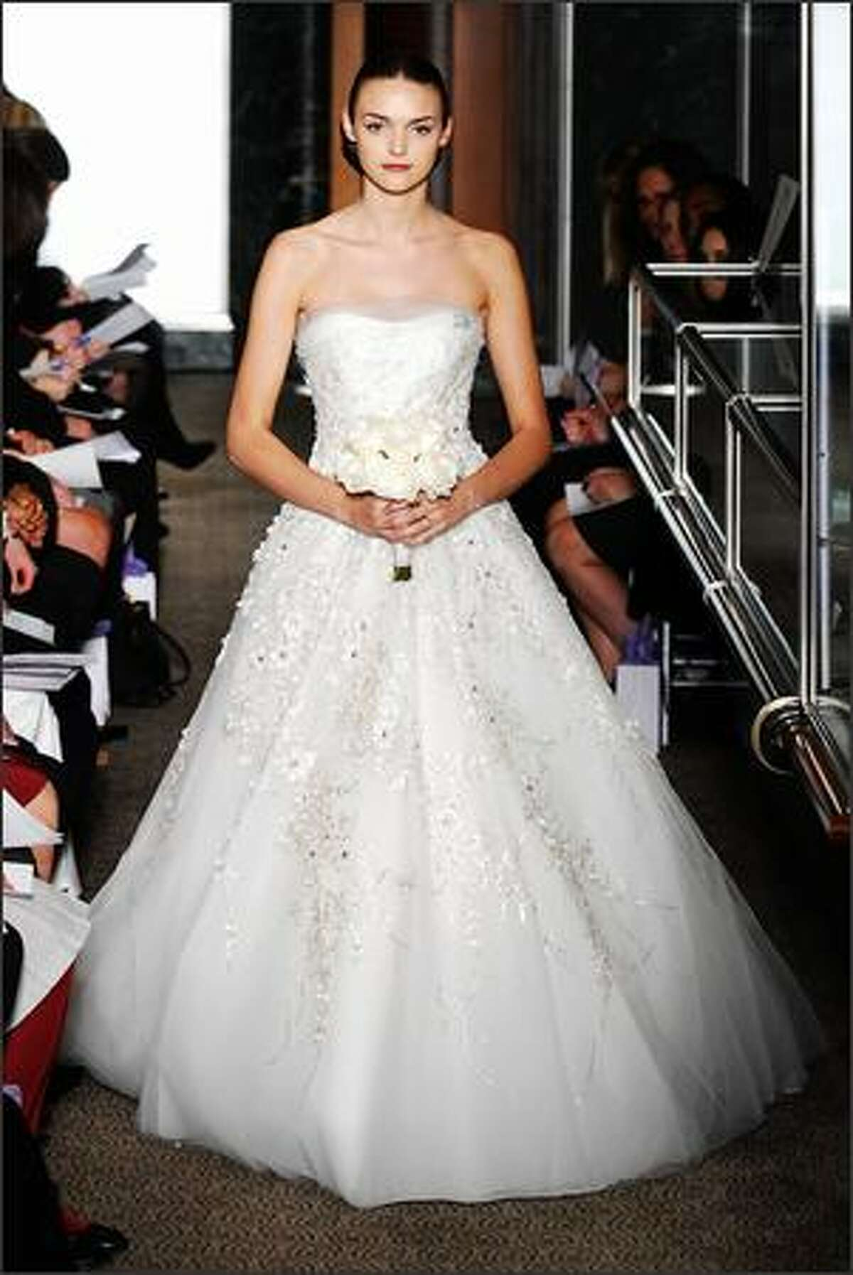 A model walks the runway at the Carolina Herrera Spring 2010 Bridal Collection at Tiffany & Co., Fifth Avenue Flagship Store in New York City.