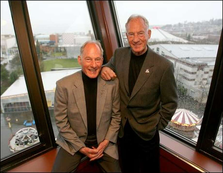 "Seattle mountain-climbing twins Jim Whittaker, left, and Lou celebrate their 80th birthdays with a party at the Space Needle on Tuesday. ""We've been lucky, and we've had a lot of fun,"" Jim said. ""It's been a great adventure."" Photo: Scott Eklund/Seattle Post-Intelligencer"