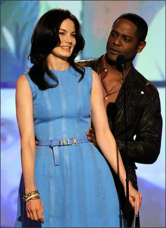 Actors Michelle Monaghan (left) and Blair Underwood speak onstage during the 24th annual Independent Spirit Awards held at Santa Monica Beach in Santa Monica, Calif., on Saturday, Feb. 21, 2009. Photo: Getty Images