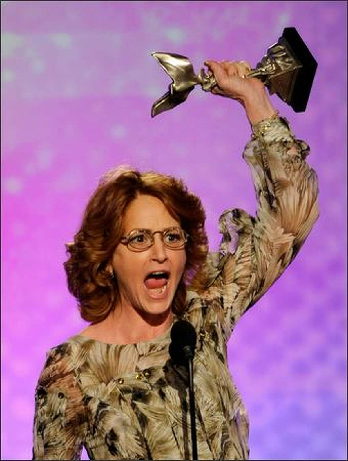 Actress Melissa Leo accepts the Best Female Lead Award for