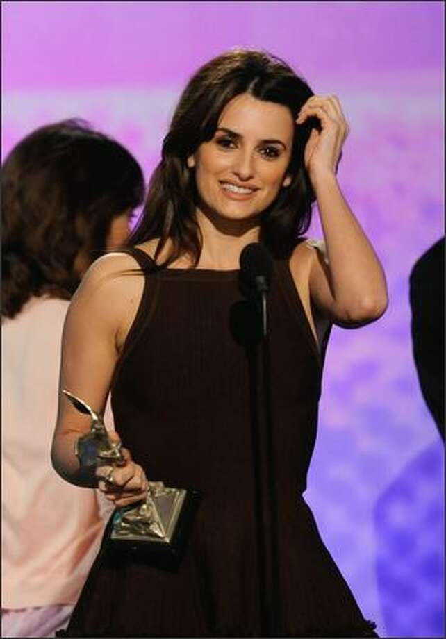 "Actress Penelope Cruz accepts the Best Supporting Female Award for ""Vicky Cristina Barcelona."" Photo: Getty Images"