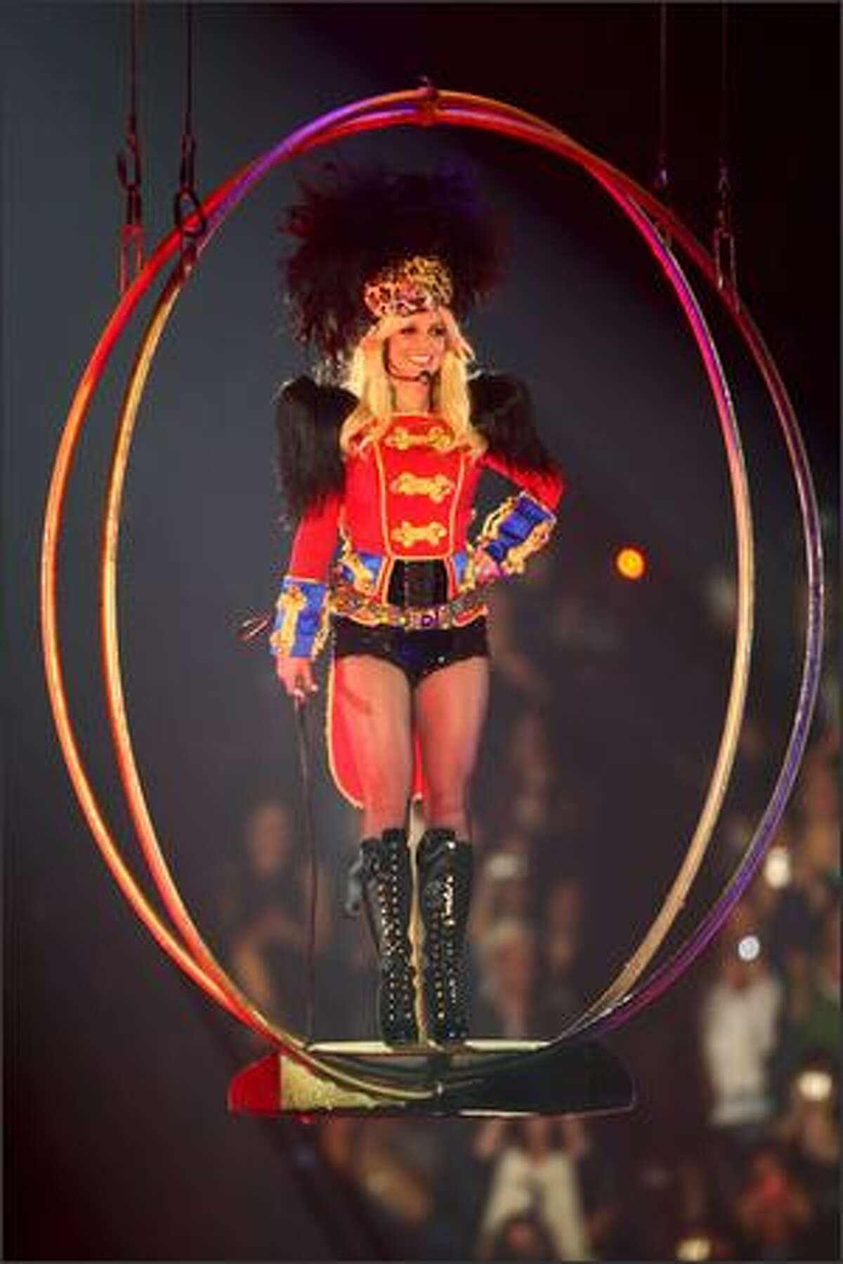 """Britney Spears descends from the rafters to begin her performance during her """"Circus"""" tour stop at the Tacoma Dome on Thursday night."""
