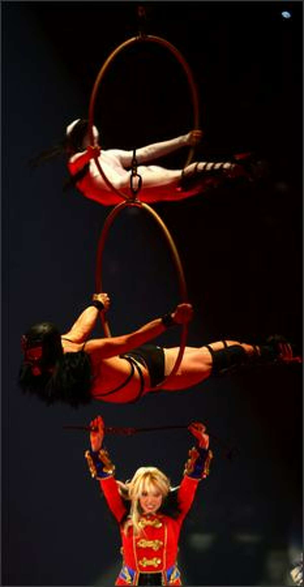 Britney Spears performs beneath acrobats from the Big Apple Circus.