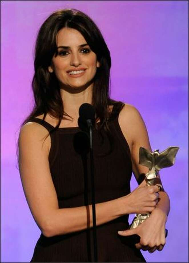 "Actress Penelope Cruz accepts Best Supporting Female Award for ""Vicky Cristina Barcelona."" Photo: Getty Images"