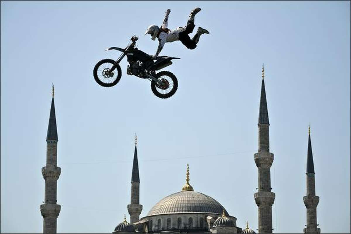A German motocross biker performs in front of the Blue Mosque in Istanbul.