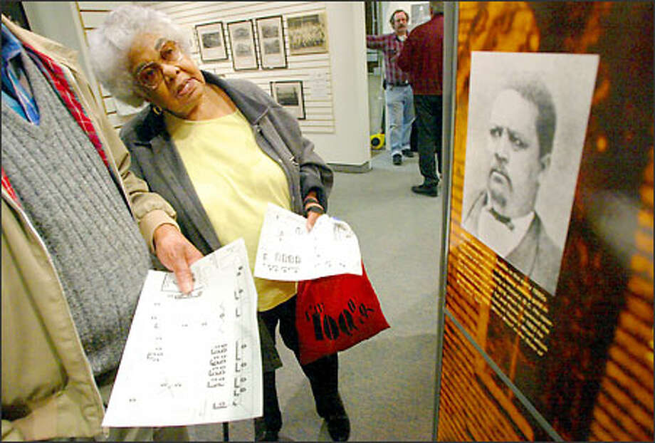 Dolores Bradley, 79, whose grandparents were the first Filipino family to settle in Seattle, looks at the exhibit on the Central District at History House in Fremont. Photo: Meryl Schenker, Seattle Post-Intelligencer