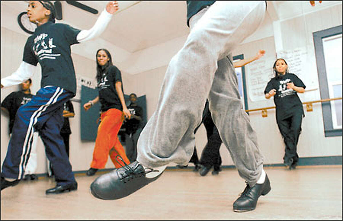 Tap-dance students make the mirror-lined walls tremble and the wooden floors shake at Talent, Tap, Acting, Arts, Performance & Production Central in the Central District in Seattle. Forty-three students practice at the TTAAPP studios.