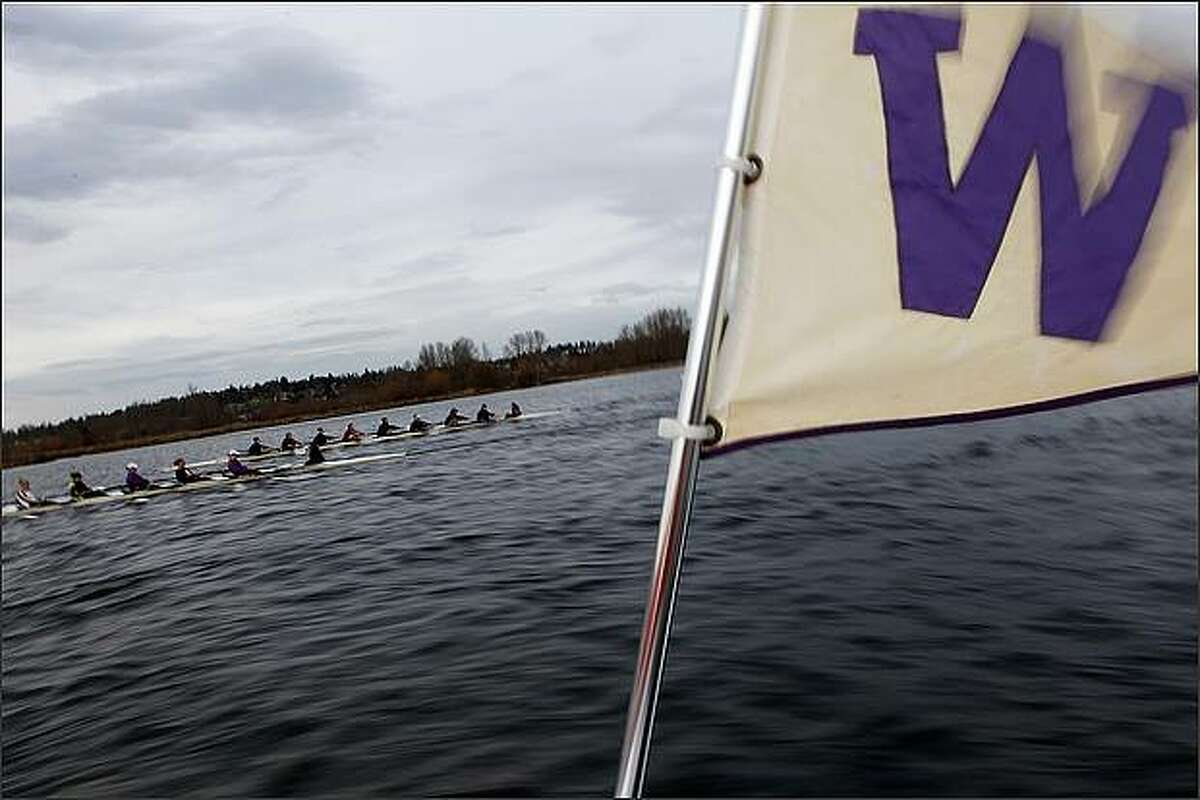 The Washington flag waves as the women's crew team practices.