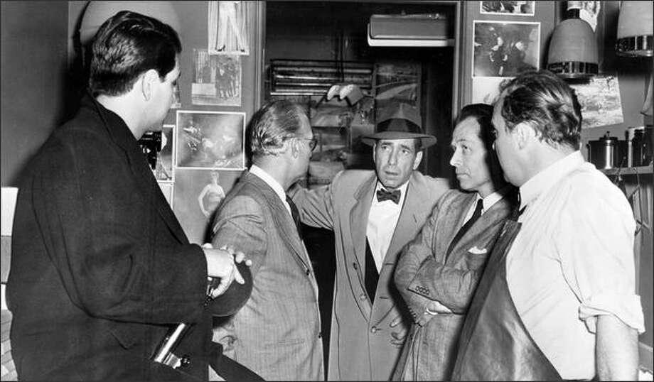 "Humphrey Bogart, center, in ""Deadline - U.S.A."" Photo: /"