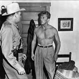 """Kirk Douglas, right, in """"Ace in the Hole."""""""