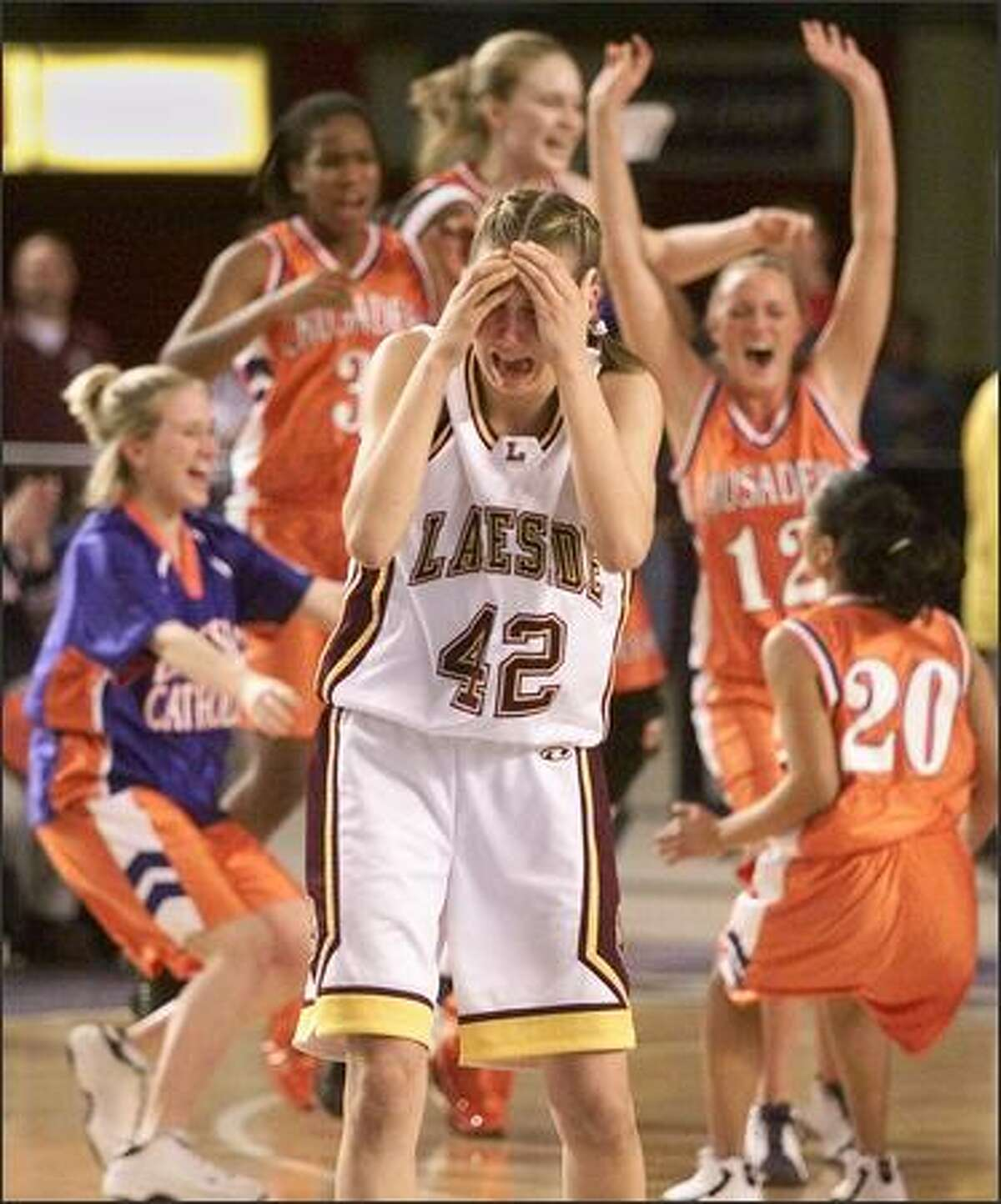 Lakeside's Eleanor Miller walks away in tears as Eastside Catholic celebrates their 49-43 victory in their semi-final game at the Tacoma Dome on March 1, 2002. (Photo by Mike Urban/Seattle Post-Intelligencer)