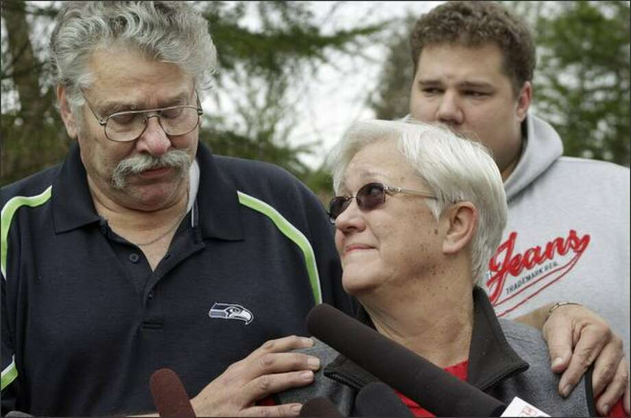 Jim and Lynn Morris, parents of Rebecca Shaw, talk to the media about their daughter outside their Maple Valley home on Friday. In the background is Shaw's brother Billy Morris. Shaw, 24, was the first officer on Flight 3407, the Colgan Air flight that crashed Thursday nigth in suburban Buffalo, killing all 49 aboard and one person on the ground. Photo: Dan DeLong/Seattle Post-Intelligencer