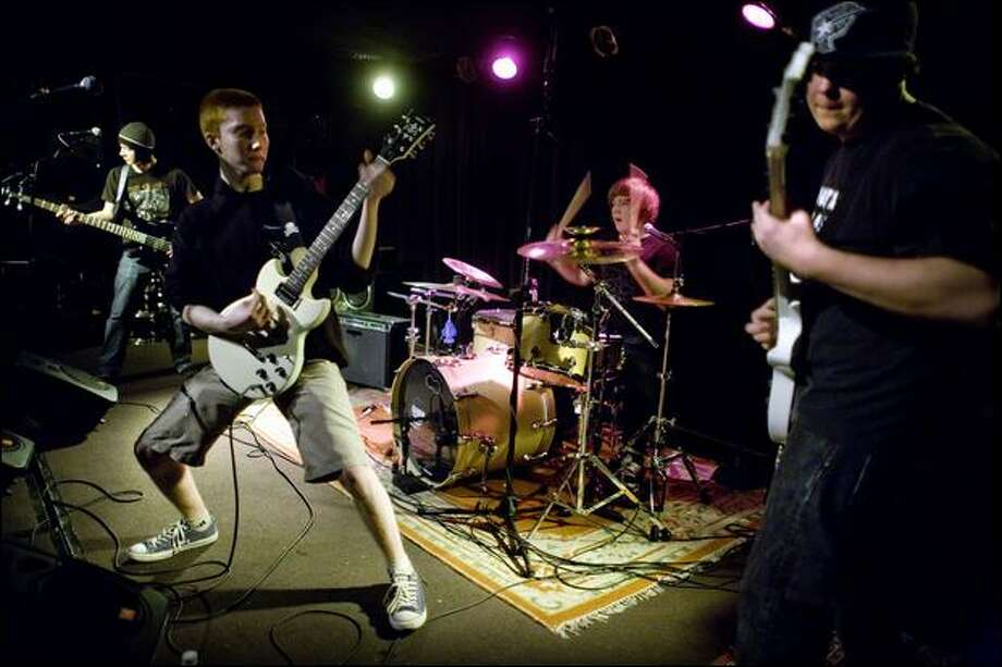 From left, Forest Jackson, Kyle Smith, Logan Johnson and Max McKinney perform their first show as the band Amelia, Count the Death in the L.A.B. on Friday. Photo: Joshua Trujillo/Seattle Post-Intelligencer