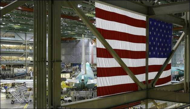 At The Boeing Co., workers are adapting to a new manufacturing process for streamlining the 737 wing assembly. Shown here is Boeing's plant in Everett. Photo: Ted S. Warren/Associated Press