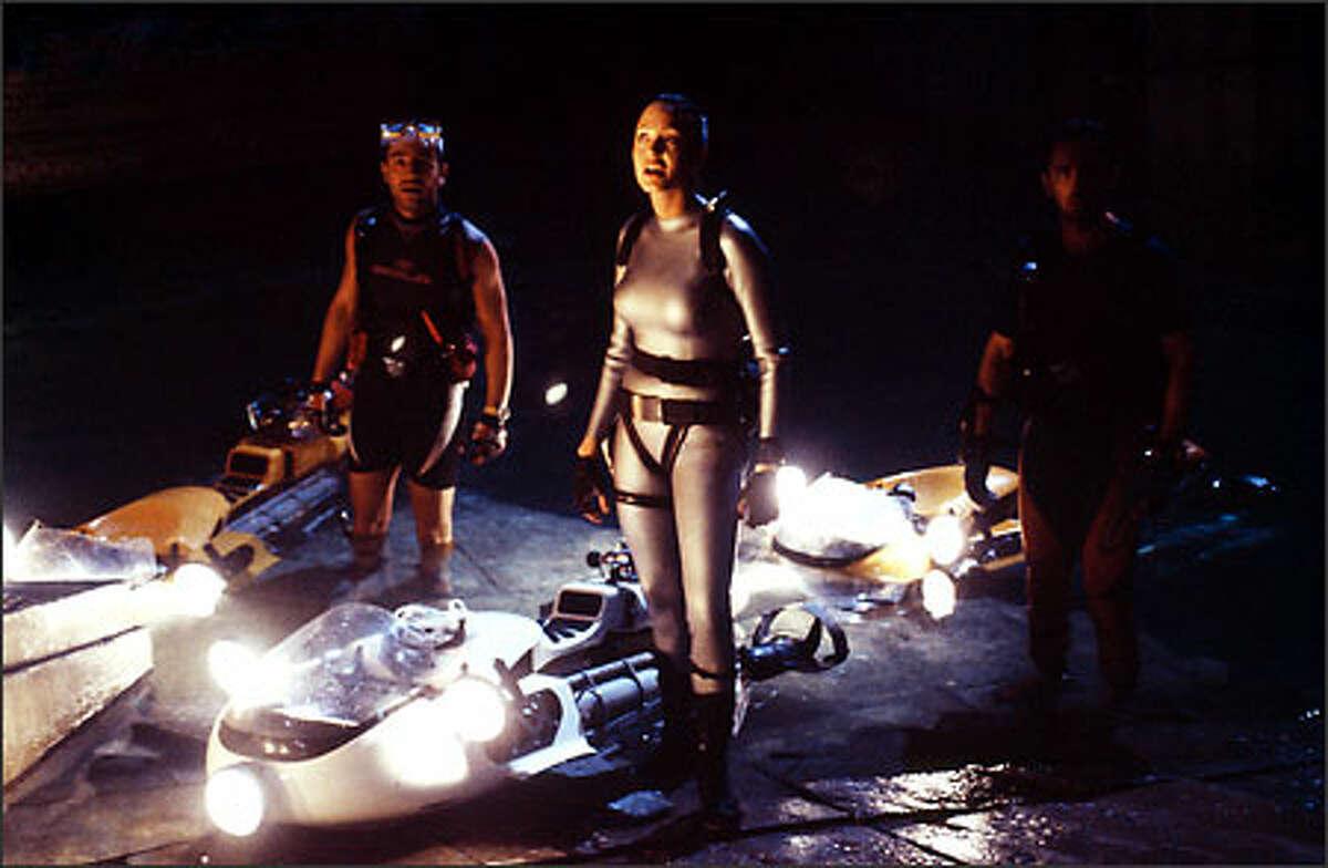 Angelina Jolie as Lara Croft with Daniel Caltagirone as Nicholas Petraki and Fabiano Martell as Jimmy Petraki.