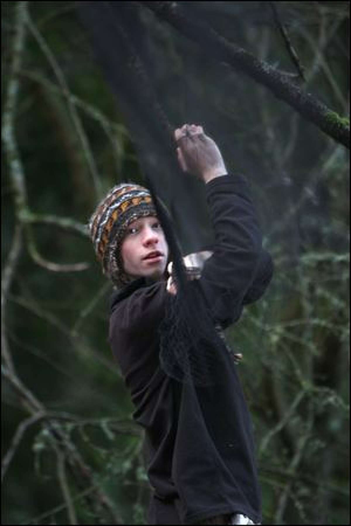 Brendan Higgins, 16, of Seattle, untangles a mist net at Seward Park.