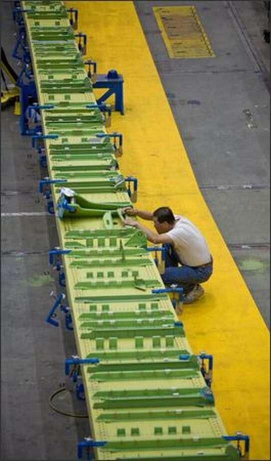 Workers assemble the first 747-8. Photo: Joshua Trujillo, Seattlepi.com