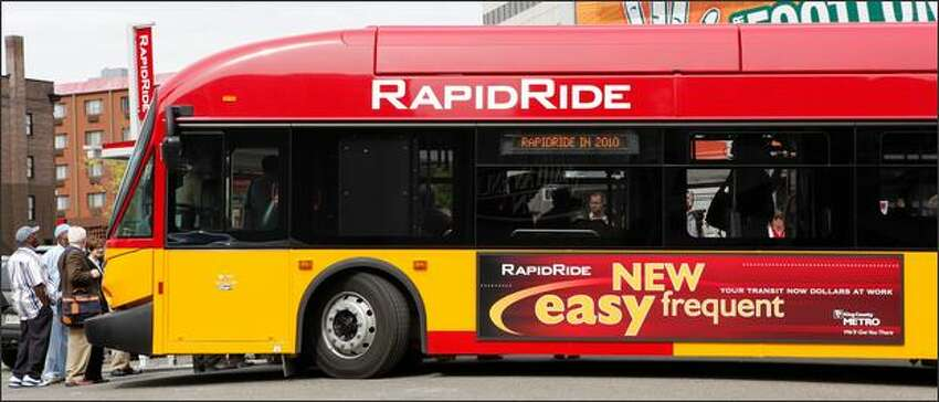 Metro's new RapidRide bus, featuring distinctive red and yellow coloring, was unveiled Monday. It will begin service in mid-2010.
